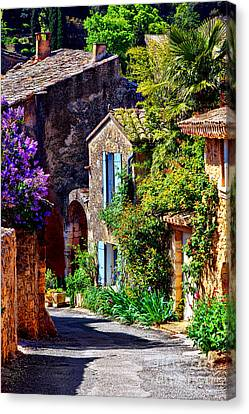 Provence Village Street In Spring Canvas Print by Olivier Le Queinec