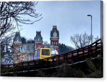 Prt Running On The Track Canvas Print by Dan Friend