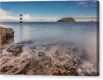 Puffin Island Lighthouse  Canvas Print by Adrian Evans