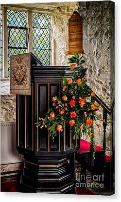Pulpit And Flowers Canvas Print by Adrian Evans