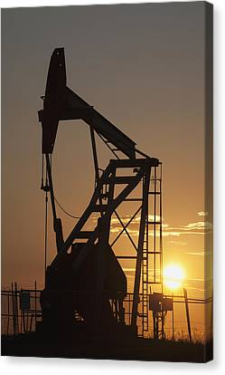 Pumpjack Silhouette Canvas Print by Michael Interisano