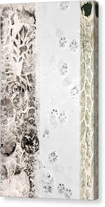 Puppy Prints In The Snow Canvas Print