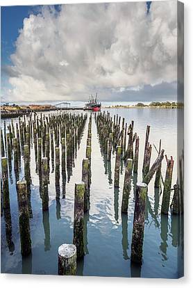 Canvas Print featuring the photograph Pylons To The Ship by Greg Nyquist