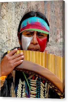 Quechuan Pan Flute Player Canvas Print by Al Bourassa