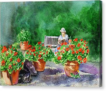 Quiet Moment Reading In The Garden Canvas Print by Irina Sztukowski