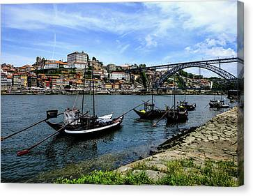 Rabelo Boats And Porto Skyline Canvas Print by Marco Oliveira