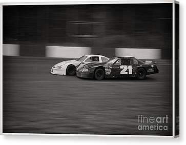Racing At The Speedway Canvas Print by Wayne Wilton