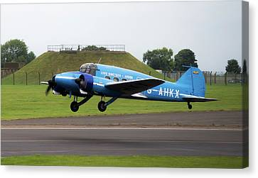 Canvas Print featuring the photograph Raf Scampton 2017 - Avro Anson Nineteen During Take Off by Scott Lyons