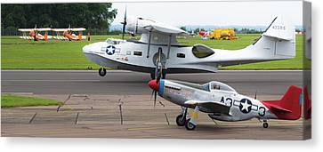 Canvas Print featuring the photograph Raf Scampton 2017 - P-51 Mustang With Pby-5a Landing by Scott Lyons