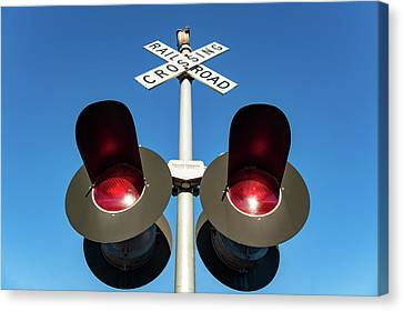 Railroad Crossing Lights Canvas Print by Todd Klassy