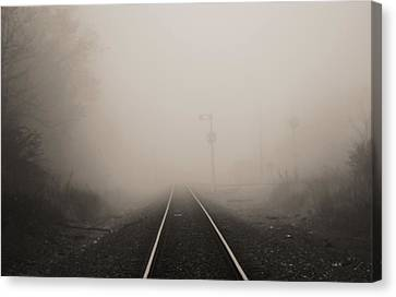 Railroad Tracks In Fog Canvas Print by Dan Sproul