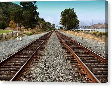 Railroad Tracks With The New Alfred Zampa Memorial Bridge And The Old Carquinez Bridge In Distance Canvas Print by Wingsdomain Art and Photography