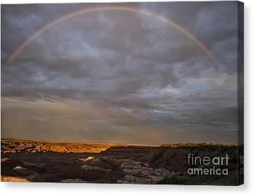 Rainbow At Sunset Canvas Print by Melany Sarafis