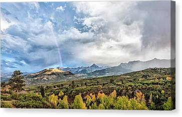 Canvas Print featuring the photograph Rainbow In The San Juan Mountains by Jon Glaser