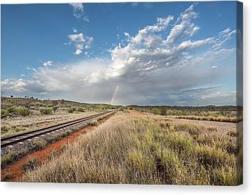 Rainbows Over Ghan Tracks Canvas Print by Racheal Christian