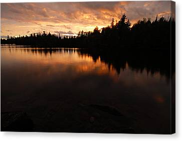 Rainclouds Clearing At Sunset Canvas Print by Larry Ricker