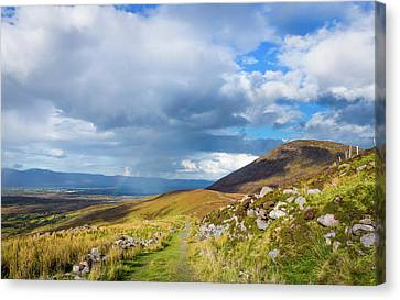 Canvas Print featuring the photograph Raining Down And Sunshine With Rainbow On The Countryside In Ire by Semmick Photo