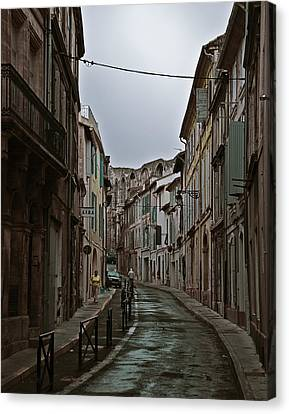 Canvas Print featuring the photograph Rainy Arles by Ron Dubin