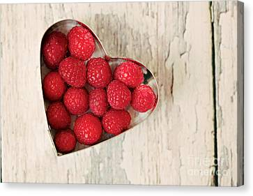 Raspberry Heart Canvas Print by Kim Fearheiley