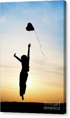 Floating Girl Canvas Print - Reach High Dream Deep by Tim Gainey