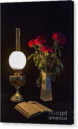 Canvas Print featuring the photograph Reading By Oil Lamp by Brian Roscorla
