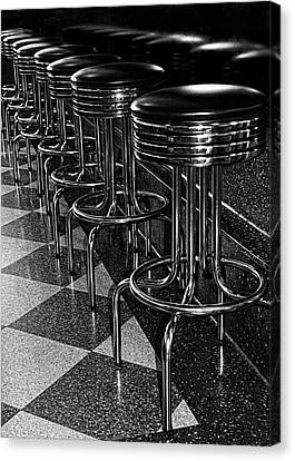 Old Diner Bar Stools Canvas Print - Ready For Business - Stools Along The Counter by Mitch Spence