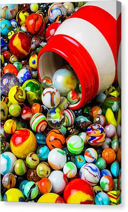 Red And White Jar With Marbles Canvas Print by Garry Gay