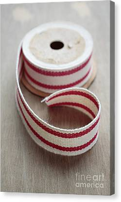 Red And White Ribbon Spool Canvas Print by Edward Fielding