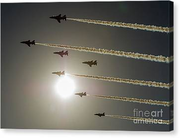 Canvas Print featuring the photograph Red Arrows Backlit Arrival  by Gary Eason