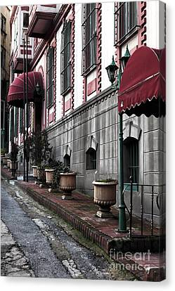 Red Awning Canvas Print by John Rizzuto