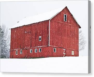 Red Barn Snow Storm  Canvas Print by Tim Fitzwater