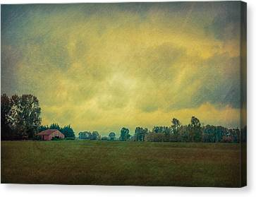 Red Barn Under Stormy Skies Canvas Print