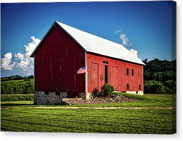 Red Barn With American Flag Canvas Print by Mountain Dreams