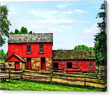 Red Barn With Fence Canvas Print by Susan Savad