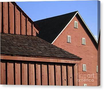 Red Barns And Blue Sky With Digital Effects Canvas Print by William Kuta