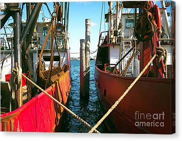 Canvas Print featuring the photograph Red Boat Docked In The Bay by John Rizzuto