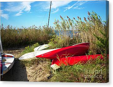 Canvas Print featuring the photograph Red Boats On The Beach by John Rizzuto