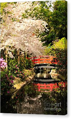 Red Bridge Reflection Canvas Print by James Eddy