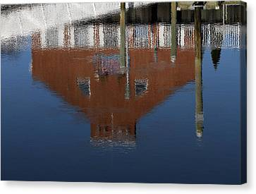 Red Building Reflection Canvas Print by Karol Livote