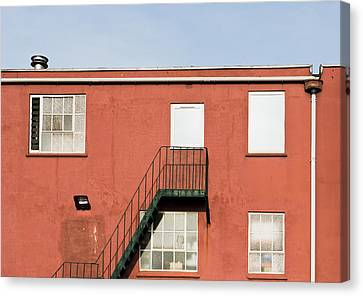 Fire Escape Canvas Print - Red Building by Tom Gowanlock