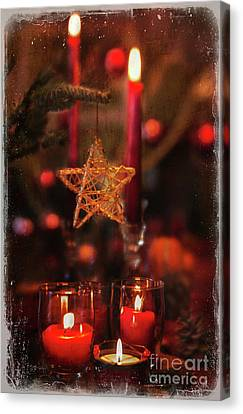 Canvas Print featuring the photograph Red Candles  by Elena Nosyreva