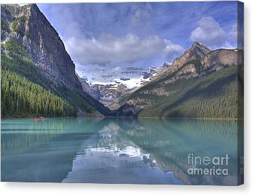 Red Canoe On Lake Louise Canvas Print by Larry Whiting