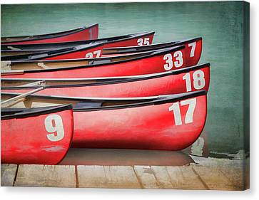 Red Canoes At Lake Louise Canvas Print by Debby Herold