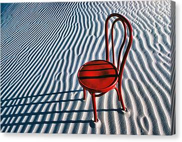 Red Chair In Sand Canvas Print by Garry Gay