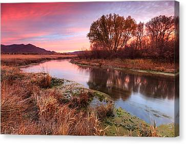 Red Dawn At Spring Creek. Canvas Print by Johnny Adolphson