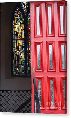 Red Door At Church In Front Of Stained Glass Canvas Print by David Bearden