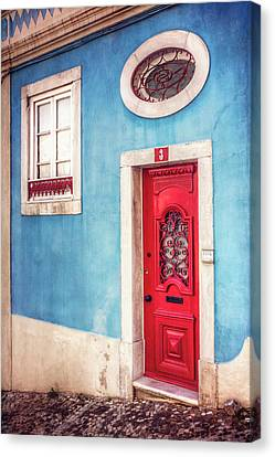 Red Door In Lisbon  Canvas Print by Carol Japp