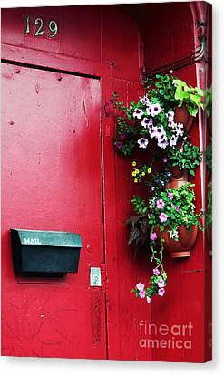 Red Door In Montreal Canvas Print by John Rizzuto