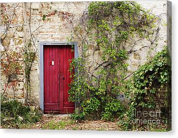 Charming Cottage Canvas Print - Red Door In Old Brick And Stone Cottage by Jeremy Woodhouse