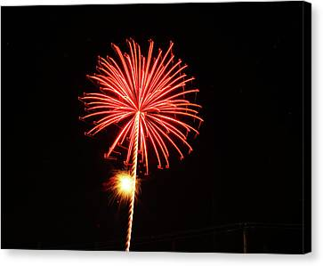 Red Fireworks Canvas Print by Laura Catherine